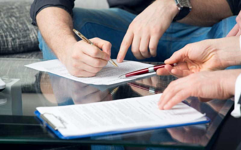 Man signing a legal agreement