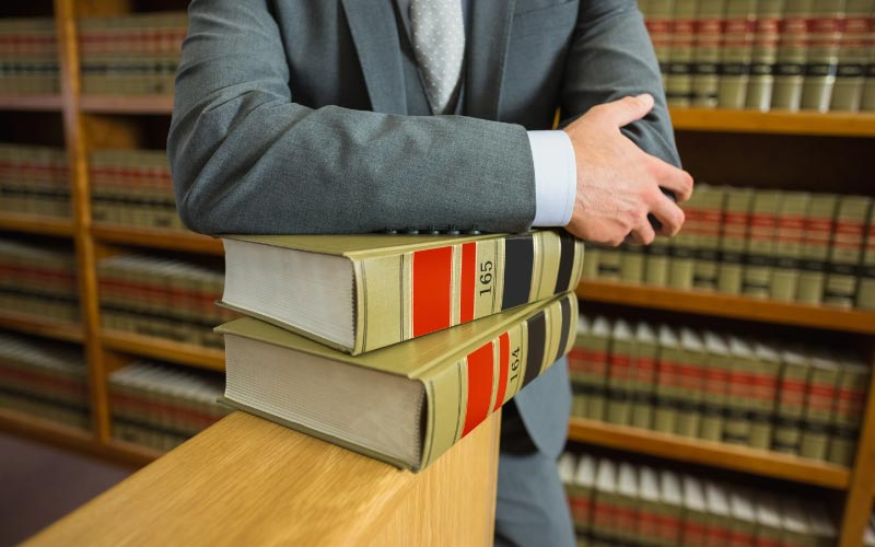 Lawyer with law books